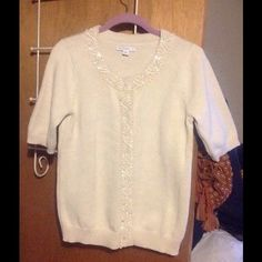 Isaac Mizrahi Live! Beaded Sweater Size Small Beautiful Isaac Mizrahi Live! sweater. Size small. Color is a cream off white. Beading all the way round the neckline and down the front. Sleeves are short almost to elbows for nice coverage. Can be worn buttoned up as a top or open as a cardigan. 100% cotton. Brand new without tags. Isaac Mizrahi Live! Sweaters