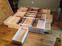 this is the perfect queen storage bedframe. it's brand new, completely assembled and in unfinished smooth pine so you can stain or paint it however you'd like. all the drawer slides are h...