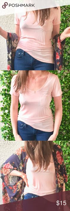 Light pink/blush tee Softest pocket tee EVER! This lightweight Banana Republic tee is like new (worn once) and is a classic must-have wardrobe staple. The color is so pretty - a perfect blend between baby pink and blush.   Note: I'd recommend wearing with a nude seamless t-shirt bra, or a thin camisole underneath (I totally didn't do this in the pic, and it's obvious!) Also, there is a cute seam down the middle on the backside of the shirt (not pictured). Banana Republic Tops Tees - Short…