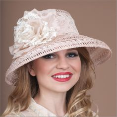 Audrey• Design by Louise Green • Fabric: Quality lacy sisal, silk & lace flower • Colors: Pale Rose w/Ivory • Size: Fits Most, adjustable with our patented silk covered elastic headband  that fits a broad range of head sizes •Style: Medium down brimmed hat • Handmade in USA