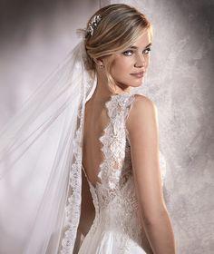 AGORA - Tulle and Chantilly mermaid wedding dress with bateau neckline…