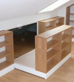 Bookshelf slides out to reveal more storage tucked into the slanted roof area. Dachausbau als Wohnraum ?fele Functionality World Loft Storage, Bedroom Storage, Loft Room, Bedroom Loft, Attic Spaces, Small Spaces, Attic Bedrooms, Attic Design, Diy Design
