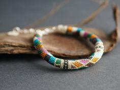 Geometric bracelet with charm silver blue purple by Kvalwasser, $90.00