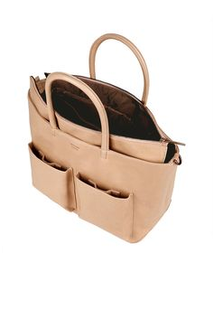 THE DETAILS Stylish and practical all at the same time, this vegan leather diaper bag will keep you and baby organized while on the go. Complete with two front patch pockets, an adjustable and removab