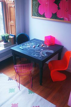 Forget paper and markers! Paint a kid's table with chalkboard paint and the kids can get creative directly on the table!