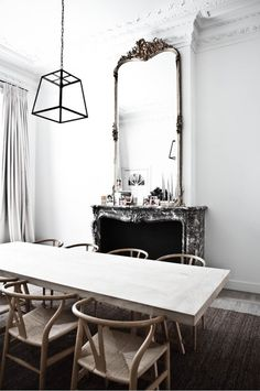 Beautiful dining room. Great mix of black and white in this space.