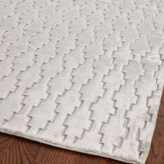 Add a touch of sophistication to your decor with this gray hand-knotted rug. Featuring a unique geometric design and a dense, silky viscose pile, this rug will stand out in any room and is extremely soft, making it comfortable to walk or sit on.