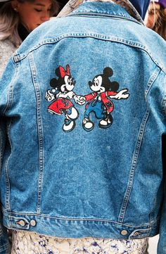 A denim jacket painted with Minnie and Mickey Mouse