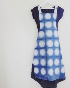 Full length apron with an easy cross-over style. Dyed using natural indigo with itajime shibori pattern on one side, and plain indigo on the reverse..  41/104 cm long 23/59 cm wide in shirt section 11/28 cm wide bib section