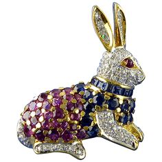 Ruby Sapphire Diamond Gold Rabbit Brooch/Pendant | From a unique collection of vintage brooches at https://www.1stdibs.com/jewelry/brooches/brooches/