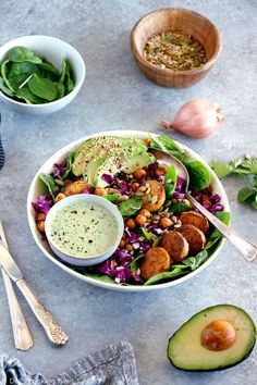 This nourishing buddha bowl recipe with green tahini sauce makes for a healthy, well-balanced meal, naturally vegan and gluten-free. It features some roasted potatoes, chickpeas, fresh vegetables and seeds, combined all together in one single bowl. #healthycooking #NewYear #Eathealthy #buddhabowl #tastyveggies Bol Buddha, Buddha Bowl, Raw Vegetables, Roasted Vegetables, Roasted Potatoes, Chickpea Recipes, Veggie Recipes, Delicious Vegan Recipes, Healthy Recipes