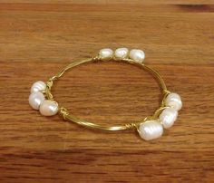 The Dianne- freshwater pearls on gold wire wrapped bangle.