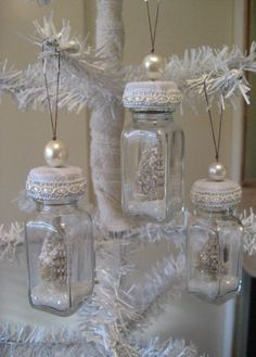 This is a set of four darling ornaments made from vintage bottles. Each bottle has a tiny vintage tree inside with glitter. This would make a