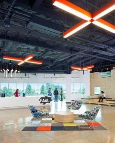 I like the simple wooden seating area in the back! And the + lights too (AOL Offices by Studio O + A)