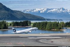 Airliners.net - An Alaska Airlines leaving Juneau backed by the beautiful local scenery.