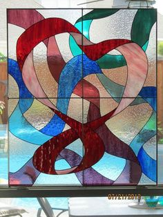"""Heart Of Ribbons - Delphi Artist Gallery  Heart of Ribbons panel project (34.5""""x41""""). Red and pink glass make up the primary ribbon, with purple, blue, and teal as the secondary ribbons"""