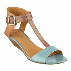 "Our Verucha wedge sandals feature and open toe with T-strap and adjustable buckle closure. Padded footbed for all-day comfort. Leather upper. Man-made lining and sole. Imported. 1 1/2"" stacked heels. Wedge sandals."