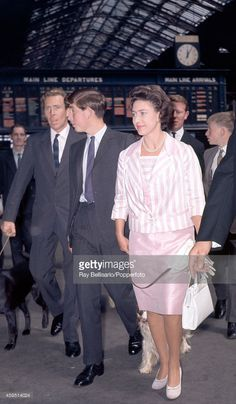 Left to right, Antony Armstrong-Jones, Prince Charles and Princess Margaret with a dog on a lead at Liverpool Street Station in London on 5th August 1963. This image is one of a series taken by Ray Bellisario who was credited with being the 'original paparazzo' and someone who frequently upset the Royal Family with his informal and often unwelcome style of photography.