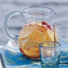 White Sangria:  peaches, plums or nectarine; peach nectar; Cointreau; dry white wine; club soda and ice cubes