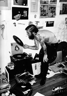 2 of my favorite things: records and a tattooed bearded man <3