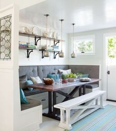 We love this rustic-inspired breakfast banquette with built in seating and a moveable bench. Check out our other breakfast room banquette ideas to add a homey and welcoming feeling to your kitchen. Kitchen Table With Storage, Kitchen Corner Bench, Kitchen Ikea, Window Seat Kitchen, Kitchen Nook, Corner Banquette, Corner Nook, Corner Table, Kitchen Shelves