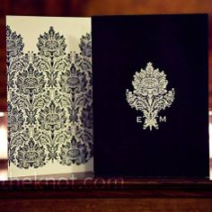 Black Damask Invitations  This bold black-and-white damask pattern inspired the wedding day stationery.