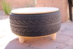 Learn how to make a DIY tire coffee table with this simple step-by-step photo tutorial. It is so easy to make your own beautiful upcycled tire table for your patio or outdoor space! Tire Furniture, Diy Furniture Decor, Recycled Furniture, Handmade Furniture, Furniture Design, Plywood Furniture, Chair Design, Modern Furniture, Homemade Home Decor