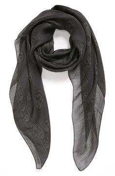$295, Charcoal Print Scarf: Alexander McQueen Skull Print Silk Chiffon Scarf Grey Black Ivory One Size. Sold by Nordstrom.