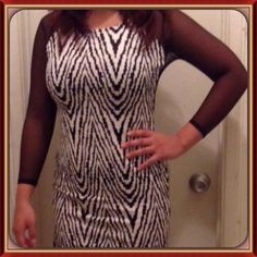 Very sexy Geometric Design Bodycon Dress Show off your Curves with this dress! Perfect on a date with some nice blk heels. It has a sexy slit on the side! Dresses
