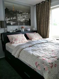 We've chosen Brimnes bed from IKEA because we needed more space. They're 2 colors option: Black & White.  We've chosen for the black color because it's more elegance.  Romantic art with Paris city view and flowerly bed cover makes also our bed little bit feminim.