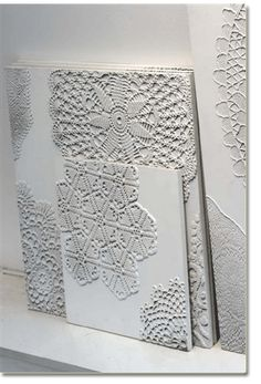 old lace doilies on a canvas, painted white.