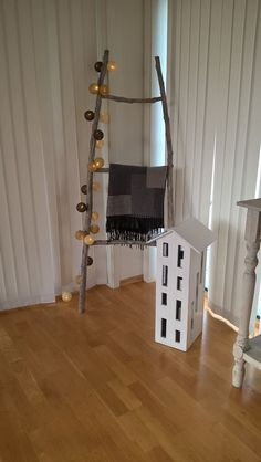 Concrete candle house & wooden decoration ladder      Made by; Trond Olsen