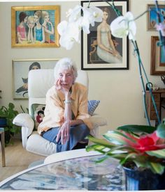 Margaret Keane. The coffee table is filled with her original inspiration sketches under the glass