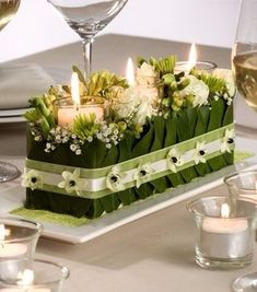 candle centerpiece - 3 candles glass cylinders pushed into green oasis holes , add white Lilly of valley, add Lilly leaves, add ribbon to hold together Flower Centerpieces, Table Centerpieces, Flower Decorations, Wedding Centerpieces, Wedding Table, Wedding Bouquets, Wedding Decorations, Centrepieces, Wedding Flowers