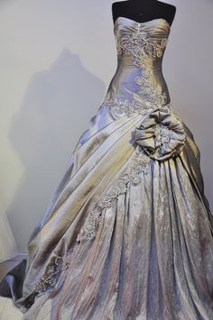 GREY WEDDING DRESS. $400.00, via Etsy. Kind of weird and I don't really like the giant flower but gorgeous!