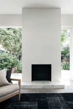 a strikingly simple fireplace, and love the black and white