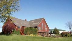 Comprised of 73 acres, the Whitney home & farm in Blue Earth County, Minnesota features a one-of-a-kind country home, a 9,000 sq ft shop, and nearly 40 tillable acres for corn and soybean crops.