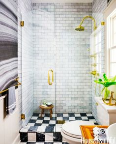 Small bathroom with marble wallpaper and varying gray tiles and a checkerboard shower floor