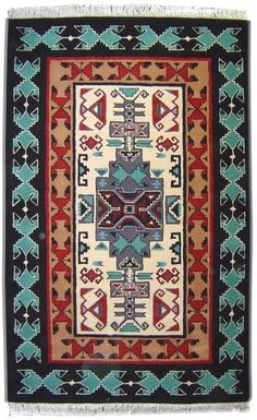 This beautiful area rug is an El Paso Saddleblanket original design, inspired by traditional Southwestern and Native American styles. Made of wool to insure durability. Available in a variety of sizes. El Paso Saddleblanket has been the leader in Southwest textiles since 1970. Our handmade rugs come in a variety of sizes and colors. Every pattern in our Southwestern area rug collection is hand-crafted, making it truly one of a kind. View our entire collection by clicking Southwest Area ...