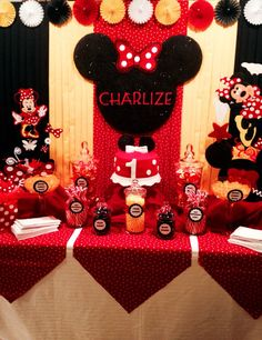 Our baby girls 1st birthday. Minnie Mouse style. Candy bar, fondant cake, decorations and a back drop from Ida's Sweet Creations.