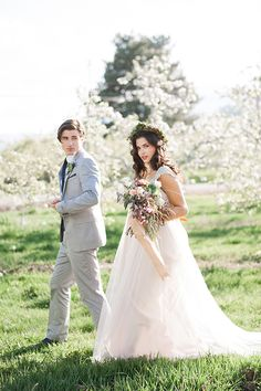 Bride-and-Groom-in-orchard,long hair brides, curls, floral crown, spring wedding, pacific brides, seattle, travel,