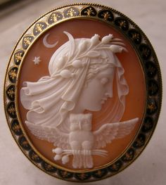 Shell, French, mid-1800's- Nyx, goddess of Night, was a feared goddess and mother of many powerful forces, including Sleep and Death. Nyx is veiled as the night, eyes closed in slumber and crowned with a wreath of sleep-inducing opium poppies. The moon and stars float above her head and her owl companion holds branches of poppies in his talons
