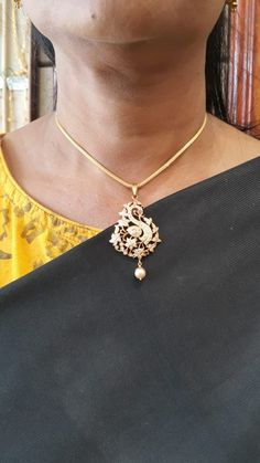 Whether you enjoy wearing your necklaces long or short, this beautiful gold diamond peacock pendant is the statement Diamond Pendant, Diamond Jewelry, Gold Jewelry, Pearl Jewelry, Fine Jewelry, Jewelery, Diamond Brooch, Indian Necklace, Indian Jewelry