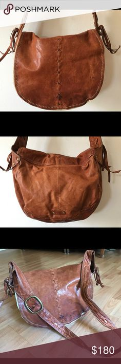 """Frye Blair Messenger Crossbody $428 Frye Leather Blair Crossbody Bag $428  Great condition! Gorgeous distressed supple Italian leather, one dark mark on front of bag, see photos. Interior has some spots  Frye adds a Western flair to the crossbody, enhancing smooth weathered leather w/interwoven detail & tassels to boot * Cognac leather * Gold hardware * Buckled strap; 20 1/2"""" drop * Flap-front closure w/crisscross woven detail * Hanging logo plate missing * Tassel detail * Twill Lining…"""