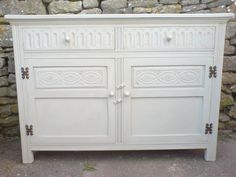 Shabby Chic facelift given to a solid wood sideboard rubbed down,painted in Farrow & Ball paint, distressed and waxed
