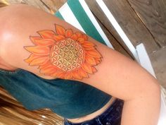 Flower of life sunflower tattoo on my upper left arm