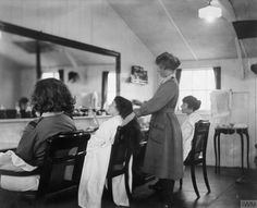 Olive Edis: A hairdressing establishment provided for women of Queen Mary's Auxiliary Army Corps (QMAAC) at RAF Pont de l'Arche, France, March Q