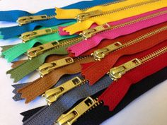 Gold metal teeth zippers TEN 10 inch brass YKK by kandcsupplies  A great zipper…