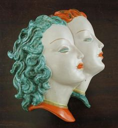 Goldscheider painted terracotta wall mask, modelled as two maidens in profile, model no.7783