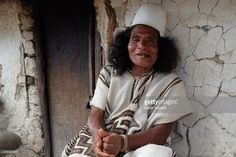 A typically dressed Arhuaco man chews Coca leaves while sat in front of a hut in the walled village (Pueblito) on January 23, 2015 Nabusimake, Colombia. Nabusimake is the spiritual center of the Arhuaco indigenous people and the place where they say the sun was born. Located high in the Sierra Nevada mountains, the community and their way of living inspire a spiritual stillness and the surrounding area is alive with virgin forests, waterfalls, and birds.